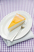 A slice of crème fraîche and vanilla cake topped with passion fruit jelly