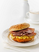 A scrambled egg and Black Forest ham sandwich