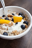 Porridge oats with blueberries, mango and walnuts