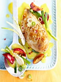 Fruity, spicy chicken breast fillet with plums and pink peppercorns