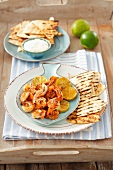Grilled prawns with limes, flour tortillas and aioli
