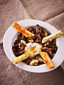Poached egg with mushrooms and savoury bread sticks