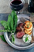 Lamb chops with potato pancakes and sorrel sauce