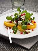 Orange salad with feta and pomegranate seeds