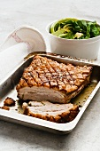 Roast pork belly with rosemary and thyme
