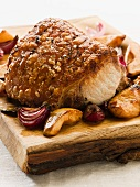 Roast crackling pork with quinces and onions