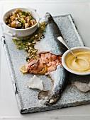Salmon with a salt crust, mayonnaise and a side salad