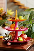 Exotic fruits on a tiered cake stand