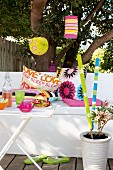Decorations for a summer garden party (lanterns, pillows and torches)