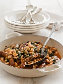 Spicy Merguez sausages with spinach and white beans
