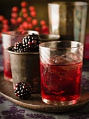 Blackberry liqueur with ice cubes