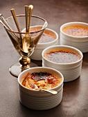 Crème brûlée and a glass holding dessert spoons