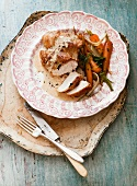 Chicken breast with a carrot and artichoke salad