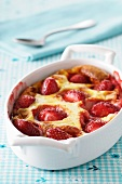 Strawberry clafoutis in the baking dish