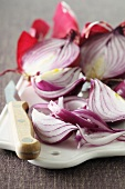 Red onions, halved and in wedges