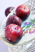 Plums in a porcelain dish