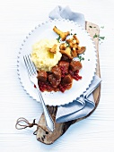 Venison goulash with potato and celeriac mash and truffle oil