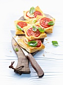 Puff pastry slices with tomatoes and basil