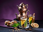Tea Eastern-style with mint, cinnamon, orange and baklava