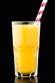 A glass of orange juice with bits of pulp