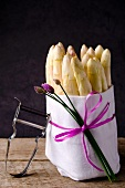 A bunch of white asparagus in a white cloth