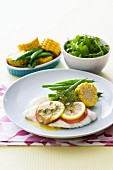 Poached fillet of fish with vegetables and a dill and butter sauce