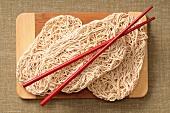 Egg noodles with chopsticks (China)