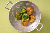 Beef tomatoes in a colander
