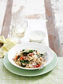 Angel's hair noodles with spinach and tomatoes