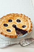 Blueberry pie with one slice removed