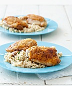 Dinner for Two; Roasted Chicken Thighs Over Rice on Blue Plates