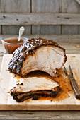 Slow Roast Pork Loin on a Cutting Board with Sauce