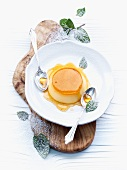 Crème caramel with mint leaves
