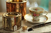 Rose tea, tea canisters and nostalgic rose tea cup
