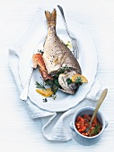 Gilthead sea bream filled with Parma ham and tomato confit