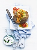 Baked potato stuffed with salmon chunks and spring onions