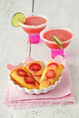 Mango-strawberry popsicles and strawberry margaritas