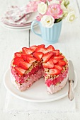 Strawberry ice cream cake with strawberry sorbet and nuts
