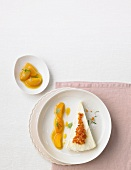 A slice of ricotta parfait with apricot compote