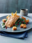 Salmon tikka masala with spinach and pomegranate seeds