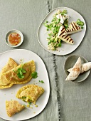 Samosas and couscous with asparagus, mint and haloumi