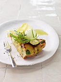 Potato tortilla with zucchini and rocket