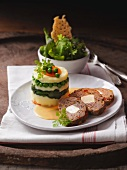 Meat loaf with a mashed potato and vegetable tower