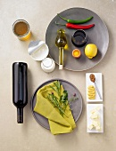 Still life with herbs, butter, mustard, foodstuff, lemon, chili peppers and wine
