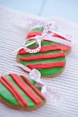 Gingerbread Christmas bauble garnished with marzipan and ribbon