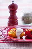 Peppers stuffed with rice and cheese filling, sour cream on top