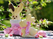 White chocolate bunnies in a springtime garden
