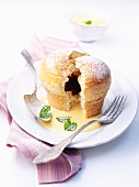 'Rohrnudeln' (Bavarian hot cross buns) with plum jam and vanilla sauce