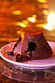 Chocolate soufflé filled with chocolate sauce