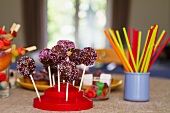 Cake pops with dark chocolate icing